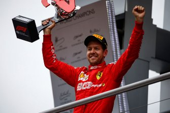 Sebastian Vettel, Ferrari, 2nd position, celebrates with his trophy on the podium
