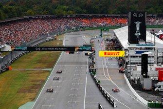 Carlos Sainz Jr., McLaren MCL34, leads Kevin Magnussen, Haas F1 Team VF-19, and Antonio Giovinazzi, Alfa Romeo Racing C38