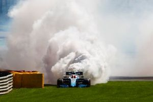Robert Kubica, Williams Racing FW42, stops with a smoking and flaming engine