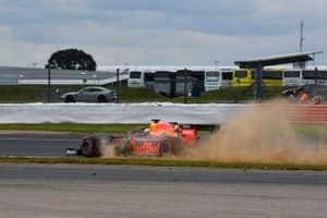 Max Verstappen, Red Bull Racing RB15, kicks up dust from the grass