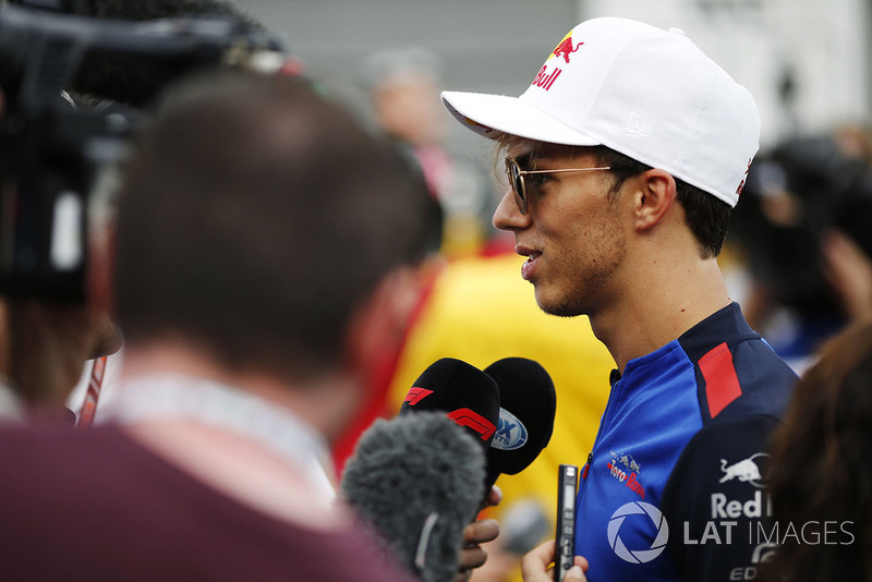 Pierre Gasly, Toro Rosso, talks to the media