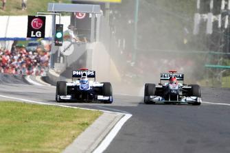 Michael Schumacher, Mercedes GP MGP W01 squeezes Rubens Barrichello, Williams FW32