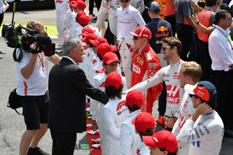 Чейз Кэри и пилот Haas F1 Team Ромен Грожан