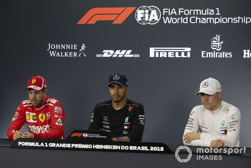 (L to R): Sebastian Vettel, Ferrari, Lewis Hamilton, Mercedes AMG F1 and Valtteri Bottas, Mercedes AMG F1 in the press conference