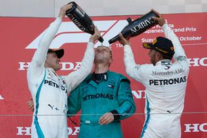 Lewis Hamilton, Mercedes AMG F1, on the podium with Valtteri Bottas, Mercedes AMG F1, spraying champagne