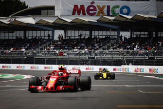 Kimi Raikkonen, Ferrari SF71H, and Nico Hulkenberg, Renault Sport F1 Team R.S. 18, arrive on the grid