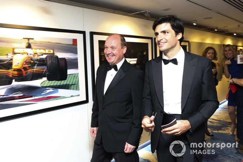 Carlos Sainz walks through the Motorsport Images display