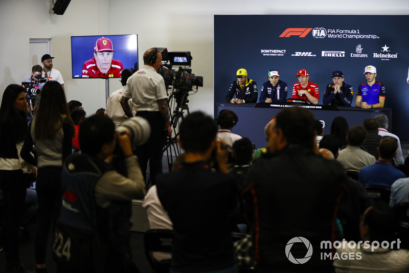 A cameraman films Carlos Sainz Jr., Renault Sport F1 Team, Sergio Perez, Force India, Kimi Raikkonen, Ferrari, Max Verstappen, Red Bull Racing, and Pierre Gasly, Toro Rosso, in the Thursday press conference.