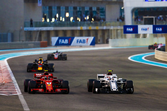 Charles Leclerc, Sauber C37, battles with Kimi Raikkonen, Ferrari SF71H, ahead of Daniel Ricciardo, Red Bull Racing RB14