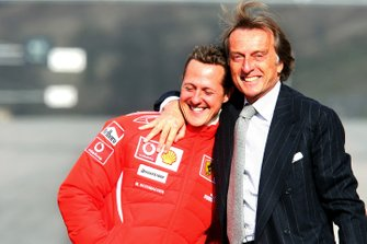 Luca di Montezemolo, Ferrari Team President, (Right) hugs Michael Schumacher
