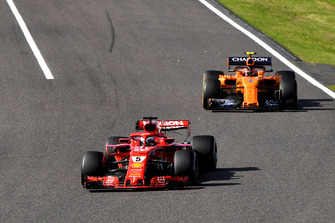 Sebastian Vettel, Ferrari SF71H leads Stoffel Vandoorne, McLaren MCL33