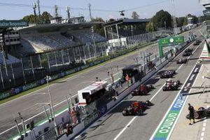 Kimi Raikkonen, Alfa Romeo Racing C39, Alex Albon, Red Bull Racing RB16, and Max Verstappen, Red Bull Racing RB16, leave the pits