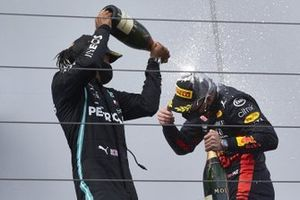 Lewis Hamilton, Mercedes-AMG F1, 1st position, sprays Max Verstappen, Red Bull Racing, 2nd position, with Champagne on the podium