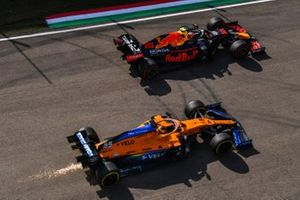 Alex Albon, Red Bull Racing RB16, battles with Carlos Sainz Jr., McLaren MCL35, as sparks fly
