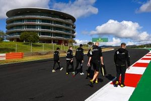 Esteban Ocon, Renault F1, walks the track with Guanyu Zhou, Renault Sport Acadmey driver