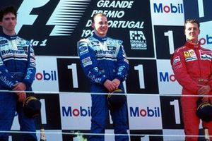 Podium: Second place Damon Hill, Williams, Race winner Jacques Villeneuve, and third place Michael Schumacher, Ferrari