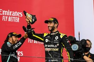 Lewis Hamilton, Mercedes-AMG F1, 1st position, and Daniel Ricciardo, Renault F1, 3rd position, drink from shoes on the podium
