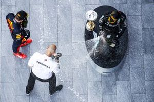 Max Verstappen, Red Bull Racing, 2nd position, and Valtteri Bottas, Mercedes-AMG F1, 1st position, celebrate with the Mercedes trophy delegate