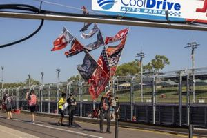 Fan with flags in the pitlane