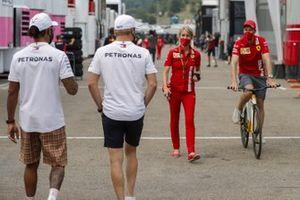 Lewis Hamilton, Mercedes-AMG F1 and Valtteri Bottas, Mercedes-AMG F1 with Sebastian Vettel, Ferrari in the paddock