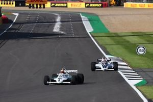 Karun Chandhok, Williams FW07C, leads Martin Brundle driving a Brabham BT49