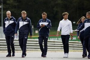 Pierre Gasly, AlphaTauri, walks the track with members of his team