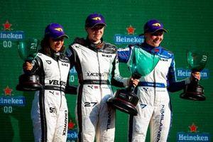 Jamie Chadwick, Race winner Alice Powell and Emma Kimilainen celebrate on the podium