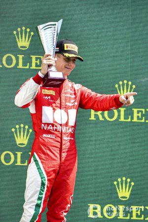 Arthur Leclerc, Prema Racing celebrates ont he podium with the trophy
