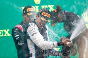 Esteban Ocon, Alpine F1, 1st position, sprays the victory Champagne