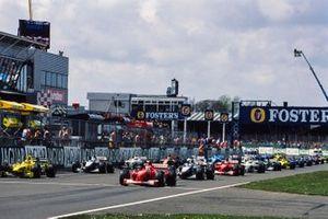 Rubens Barrichello, Ferrari F1-2000, and Heinz-Harald Frentzen, Jordan EJ10 Mugen-Honda, on the front row of the grid.