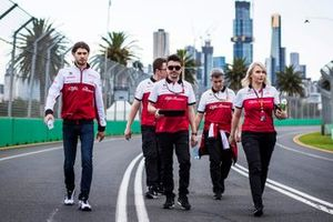 Antonio Giovinazzi, Alfa Romeo walks the track with members of the team