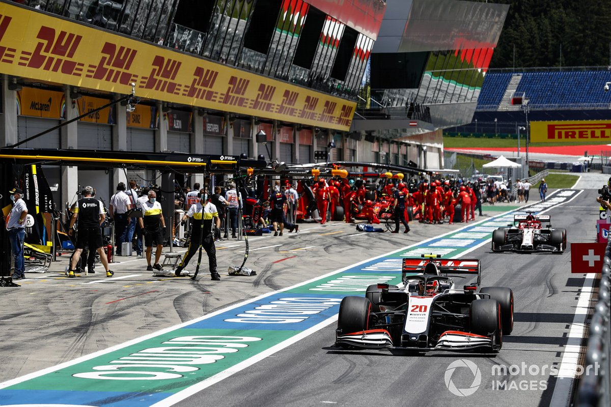Kevin Magnussen, Haas VF-20, leads Kimi Raikkonen, Alfa Romeo Racing C39, out of the pits