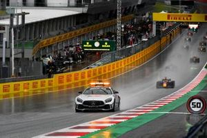 The Safety Car leads Yuki Tsunoda, Carlin, and the rest of the field