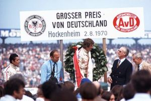 Jochen Rindt celebrates victory with second place Jacky Ickx. On the right Duke of Metternich and Huschke von Hanstein