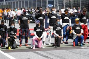 Drivers stand and take the knee in support of the End Racism campaign