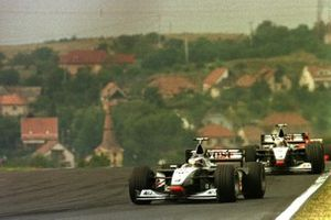 Mika Hakkinen, McLaren MP4/13 Mercedes-Benz leads David Coulthard, McLaren MP4/13 Mercedes-Benz