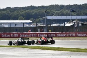 Romain Grosjean, Haas VF-20, and Max Verstappen, Red Bull Racing RB16, run side by side