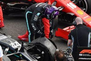 Lewis Hamilton, Mercedes-AMG F1, 1st position, inspects his puncture in Parc Ferme