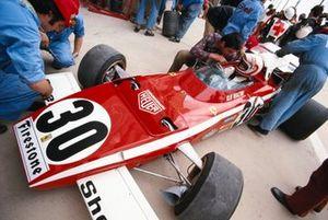 Clay Regazzoni sits in his Ferrari 312B2