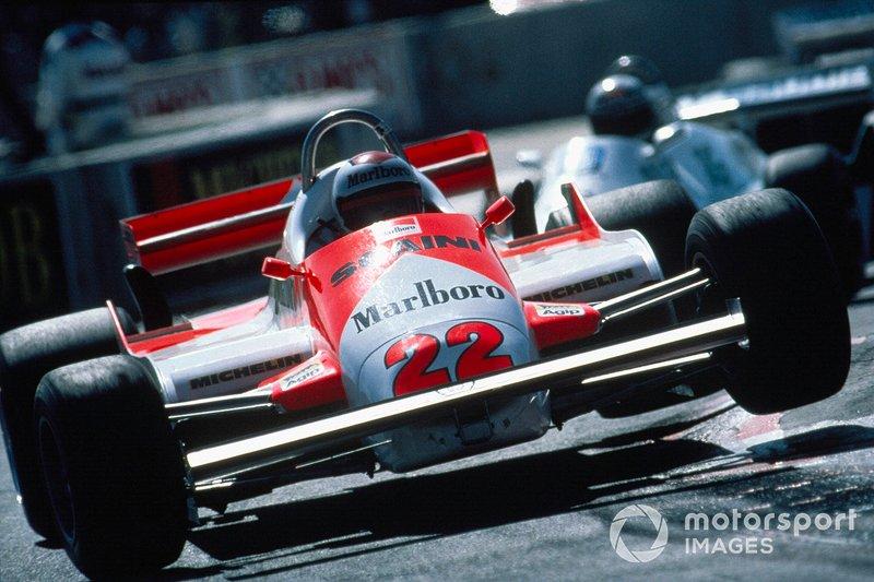 Mario Andretti, Alfa Romeo 179C, bounces over a kerb