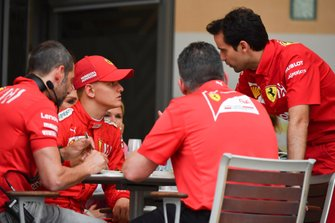 Mick Schumacher, Ferrari, sits with the Ferrari team at lunch