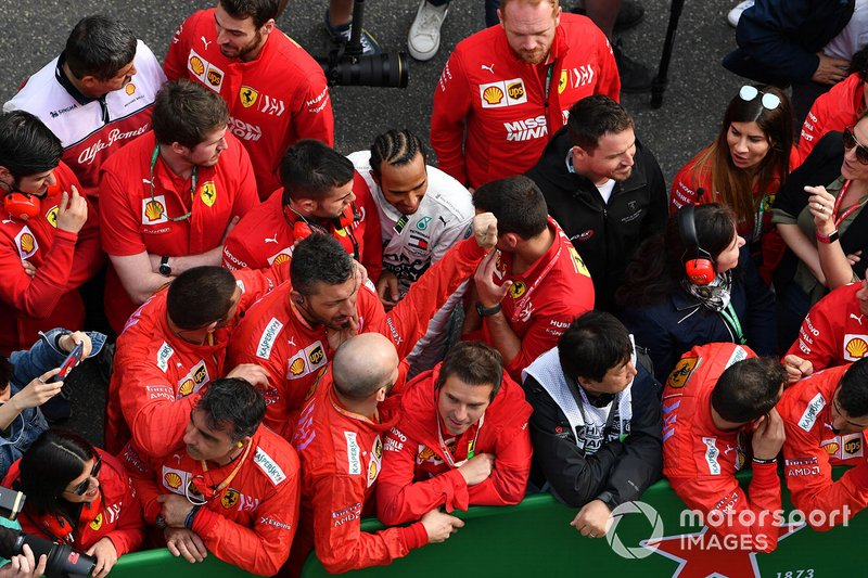 Lewis Hamilton, Mercedes AMG F1, 1st position, talks to Ferrari team personnel after the race
