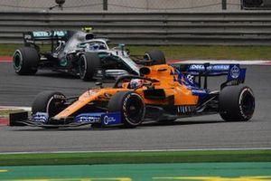 Carlos Sainz Jr., McLaren MCL34, leads Valtteri Bottas, Mercedes AMG W10