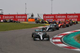 Lewis Hamilton, Mercedes AMG F1 W10, leads Valtteri Bottas, Mercedes AMG W10, Charles Leclerc, Ferrari SF90, Sebastian Vettel, Ferrari SF90, Max Verstappen, Red Bull Racing RB15, and the rest of the field at the start