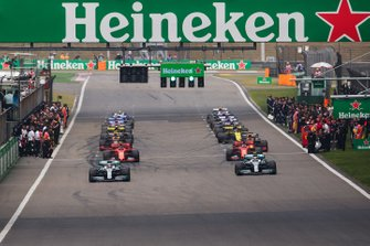 Lewis Hamilton, Mercedes AMG F1 W10, and Valtteri Bottas, Mercedes AMG W10, lead the field away for the start of the formation lap