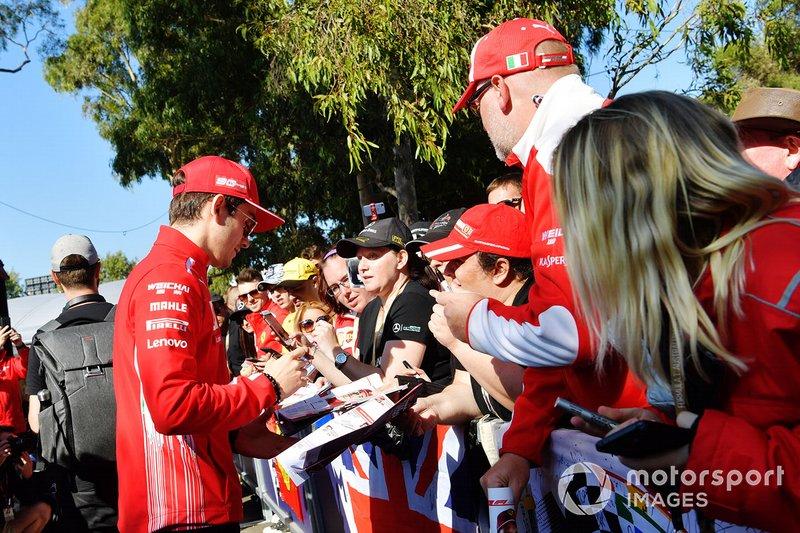 Charles Leclerc, Ferrari, signs an autograph