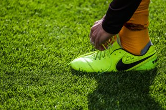 Roma footballer Francesco Totti ties his boots