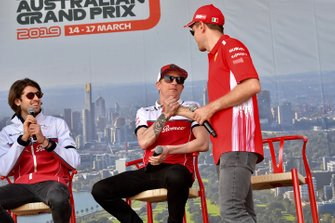 Antonio Giovinazzi, Alfa Romeo Racing, Kimi Raikkonen, Alfa Romeo Racing, and Sebastian Vettel, Ferrari, on stage