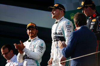 Lewis Hamilton, Mercedes AMG F1, 2nd position, Valtteri Bottas, Mercedes AMG F1, 1st position, and Max Verstappen, Red Bull Racing, 3rd position, on the podium
