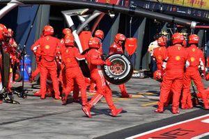 The Ferrari pit crew spring into action